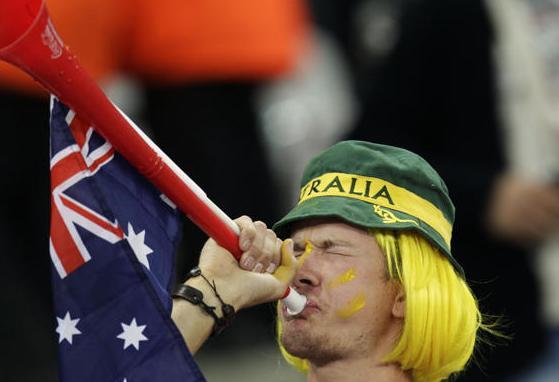 Aussie fan takes a swig from flask.