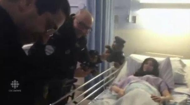 Const. Jean-Pierre Brabant visits new baby with police teddy bear CBC