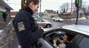 Const. Amélie Brien gives a driver $100 CBC