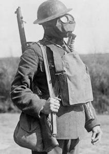 Photograph of a Soldier wearing a gas mask and helmet, 1917