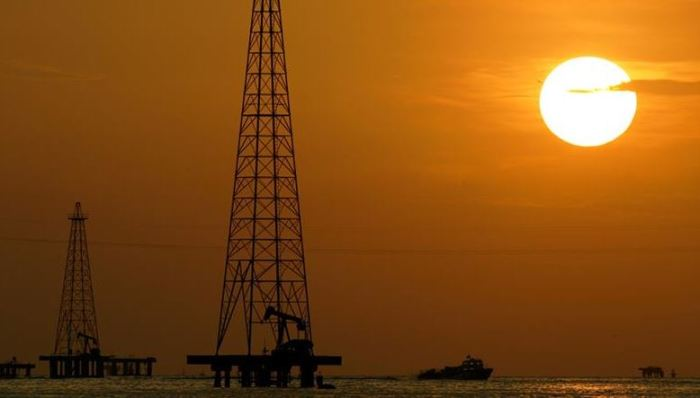 Oil drills are seen in Maracaibo Lake in Venezuela's oil-rich Zulia state in this 2006 file photo [Leslie Mazoch/AP]