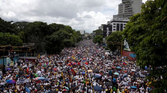 Opposition supporters take part in a rally to demand a referendum to remove Venezuela's President Nicolas Maduro in Caracas on Sept. 1. Credit: Carlos Garcia Rawlins/Reuters
